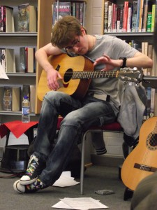 Performing @ Rathcoole Library. Photo by Minwen 2013.