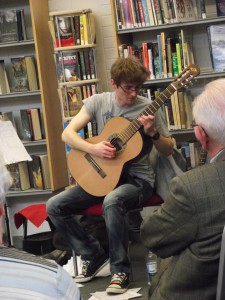 Performing classical guitar @ Rathcoole Library. Photo by Minwen 2013.